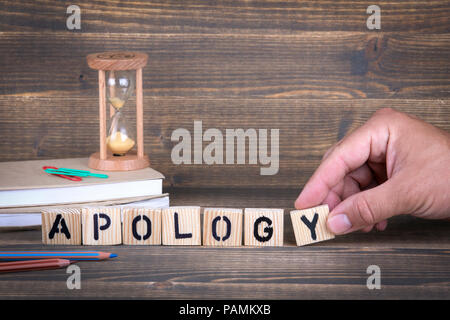 Apology. Wooden letters on the office desk - Stock Photo