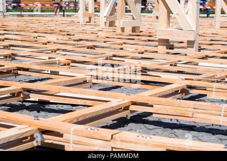 Wood planks with bolted joists from a parametric pavillion - Stock Photo