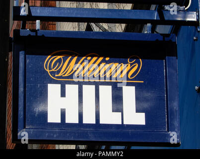 Basingstoke, United Kingdom - July 05 2018:   A Hanging Sign outside William Hill Bookmakers in London Street - Stock Photo