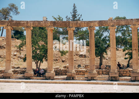 The ruined stones, concrete slabs and pillars in the ancient Mediterranean city of Jerash, Jordan - Stock Photo