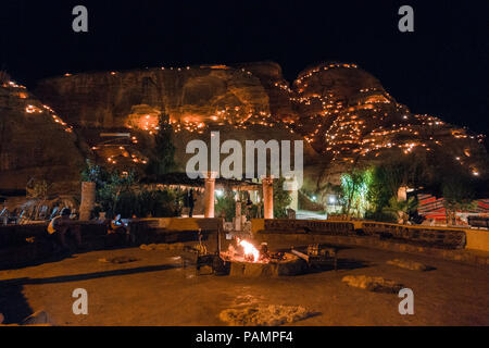 the view at night over the common area of a tourist Bedouin camp in Wadi Musa, near Petra, Jordan - Stock Photo