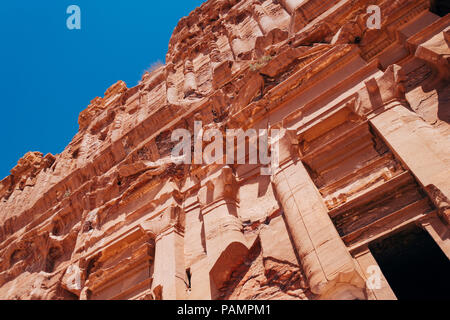 A tomb entrance carved into the rock in the Lost City of Petra, Jordan - Stock Photo