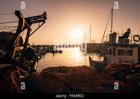 Fishing boats docked at the marina during a summers evening in the Port of Jaffa, Tel Aviv, Israel - Stock Photo