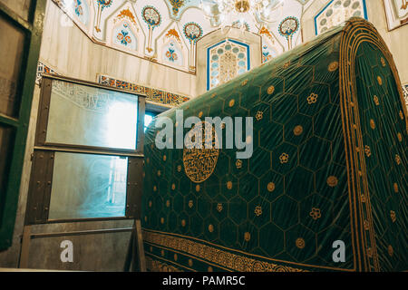 a pane of bulletproof glass obscures direct line of sight between the Muslim and Jewish sides of the tomb in Cave of the Patriarchs / Ibrahimi Mosque - Stock Photo