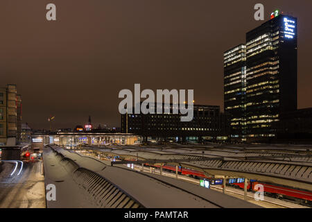 Oslo central train station on a winter night - Stock Photo