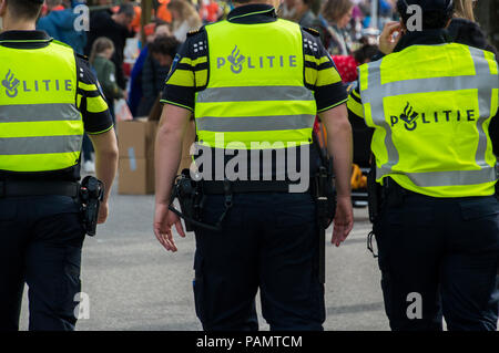 Policemen At The Vondelpark On Kingsday Amsterdam The Netherlands 2018 - Stock Photo