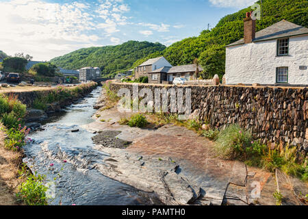 2 July 2018: Boscastle, North Cornwall, UK - the coastal village of Boscastle, with cottages and the River Valency running through it with a slate str - Stock Photo