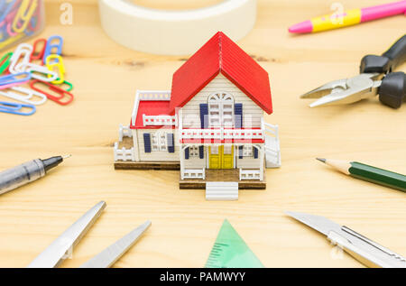 Home Improvement Concept. Home improvement background including Scissors Pen Paper Clip Sticky tape Pliers Pencil Cutter Water Level - Stock Photo