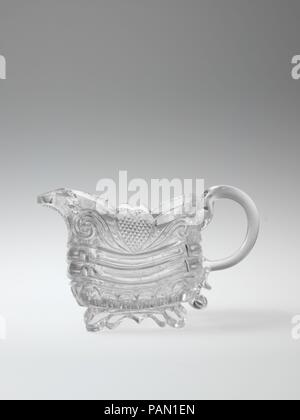 Cream pitcher. Culture: American. Dimensions: H. 3 5/8 in. (9.2 cm). Maker: Probably New England Glass Company (American, East Cambridge, Massachusetts, 1818-1888). Date: 1827-35. Museum: Metropolitan Museum of Art, New York, USA. - Stock Photo