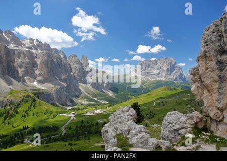 Sella Group mountains (on the left) and Sassolungo mountain (on the right) viewed from a hiking path in Puez Odle Natural Park, Val Gardena, Dolomites - Stock Photo