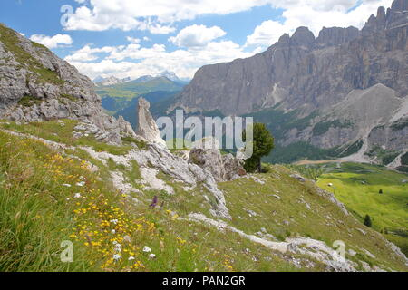 Sella Group mountains (on the right) viewed from a hiking path in Puez Odle Natural Park, Val Gardena, Dolomites, Italy - Stock Photo