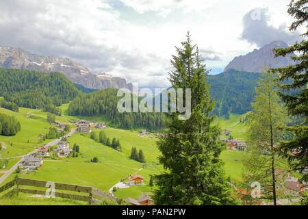 Selva viewed from the Way of the Cross with Sella Group mountains (on the left) and Sassolungo mountain (on the right) in the background, Val Gardena, - Stock Photo