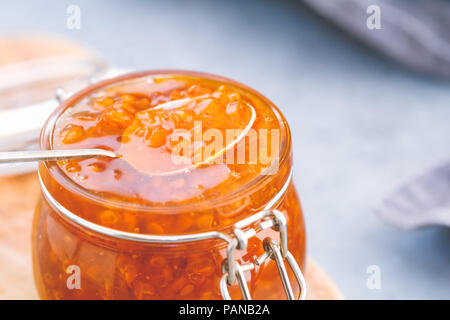 Glass jar with cloudberry jam. Nordic cuisine. - Stock Photo