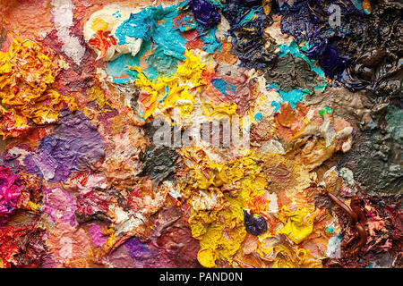 Mixed colors of oil paint on a classical palette - Painter's palette - Stock Photo