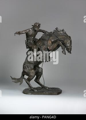 The Broncho Buster. Artist: Frederic Remington (American, Canton, New York 1861-1909 Ridgefield, Connecticut). Dimensions: 32 1/4 x 27 1/4 x 15 in. (81.9 x 69.2 x 38.1 cm). Date: 1895, revised 1909, cast by November 1910.  In his quest for perfection, Remington worked on an enlarged version of his first and most popular sculpture, 'The Broncho Buster,' during the last year of his life. For the original work, completed in 1895, the artist adapted the subject, a cowboy breaking in a rearing horse, from his drawing 'A Pitching Broncho,' published in 'Harper's Weekly' in 1892. This later version w - Stock Photo