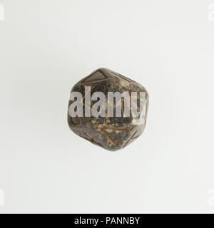 Twenty-sided die (icosahedron) with faces inscribed with Greek letters. Dimensions: Height: 2.7 x L: 3 x W: 2.8 cm (1 1/16 x 1 3/16 x 1 1/8 in.). Date: 2nd century B.C.-4th century A.D..  A number of polyhedral dice made in various materials have survived from the Hellenistic and Roman periods, usually from ancient Egypt when known. Several are in the Egyptian or Greek and Roman collections at the Museum. The icosahedron - 20-sided polyhedron - is frequent. Most often each face of the die is inscribed with a number in Greek and/or Latin up to the number of faces on the polyhedron.   Nothing sp - Stock Photo
