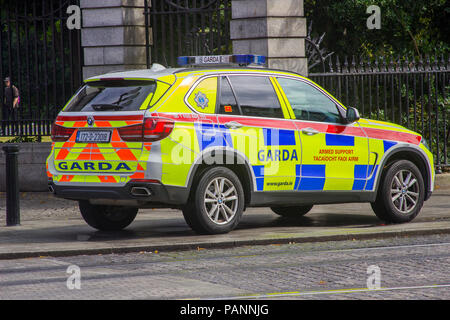 20 July 2018 An Irish police car parked on the pavement while the Garda answer an emergency in Phoenix Park Dublin Ireland - Stock Photo