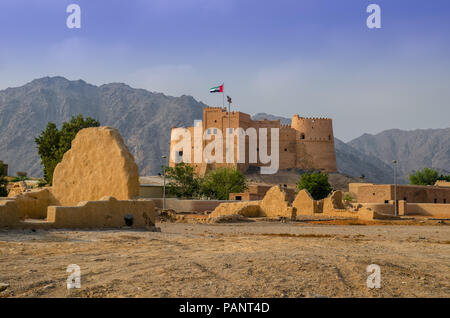 Fujairah fort with a view of ancient village ruins.This fort was built from local materials involving stone, gravel, clay, hay, and gypsum. - Stock Photo