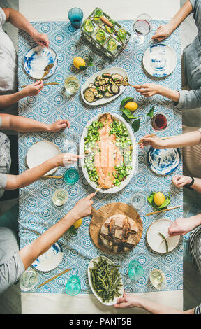 Family or friends having seafood summer dinner - Stock Photo