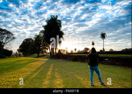 Photographing the sunset in Jesuit ruins - Stock Photo