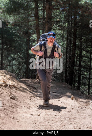 Nepal, Solo Khumbu, Everest, Sagamartha National Park, Mountaineer hiking wwith rucksack - Stock Photo