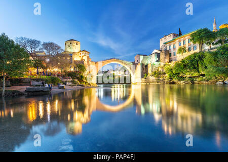 Bosnia and Herzegovina, Mostar, Old town, Old bridge and Neretva river at blue hour - Stock Photo