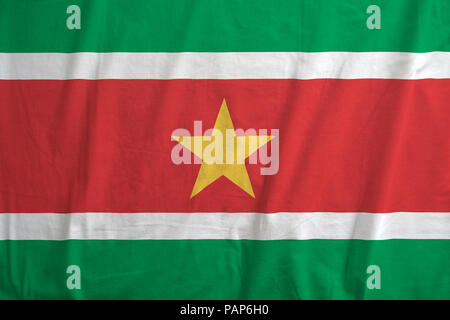 Fabric texture of the flag of Suriname. - Stock Photo