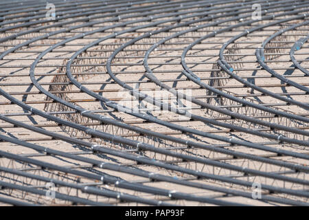 Steel Rebars for reinforced concrete. Closeup of Steel rebars. Geometric alignment of Rebars on construction site - Stock Photo