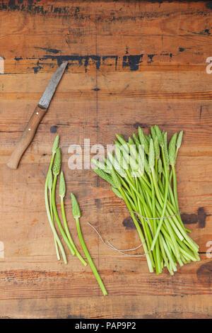 Green wild asparagus on wood - Stock Photo