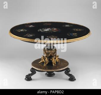 Marble-top table. Culture: Italian, Florence. Designer: Theophil Hansen (Danish, Copenhagen 1813-1891 Vienna). Dimensions: Height (stand): 30 1/2 in. (77.5 cm); Diameter (table top): 51 in. (129.5 cm). Founder: Cast by Hagenmeyer. Maker: Stand executed by Heinrich Dübell (active ca. 1853-80). Manufactory: Top executed at Opificio delle Pietre Dure, Florence, Italy. Modeler: Bronze sculptures modeled by Josef Dollischek (active 1865-72). Date: ca. 1855-60.  When this table arrived at the Metropolitan, it was thought to have been made in Florence about 1880; however, Museum curator James Parker  - Stock Photo