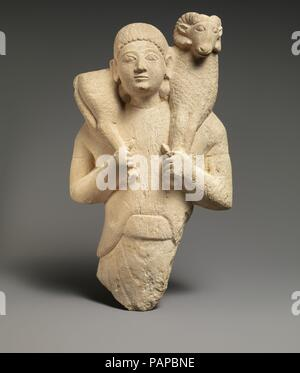 Limestone ram-bearer. Culture: Cypriot. Dimensions: Overall: 13 x 7 x 4 in. (33 x 17.8 x 10.2 cm). Date: second quarter of 6th century B.C..  Images of worshipers bringing an animal for sacrifice emphasize the importance of agriculture and animal husbandry for the subsistence of the community. Such limestone examples have been found not only on Cyprus but also in sanctuaries on Samos and Rhodes, for instance. More modest representations exist in terracotta. Museum: Metropolitan Museum of Art, New York, USA. - Stock Photo