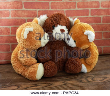 hug three bear toy and doll brown and light brown with vintage wall - Stock Photo