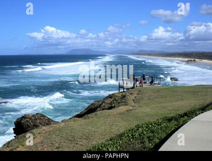 People standing on deck overlooking Lighthouse beach in New South Wales coastal town of Port Macquarie in Australia. - Stock Photo