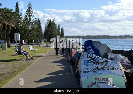 People walking enjoying day out at Breakwall coastal town of Port Macquarie in New South Wales, Australia on 10 July 2018. - Stock Photo