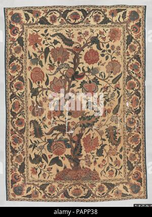 Bed Cover (Palampore). Dimensions: Textile: H. 107 in. (271.8 cm)   W. 77 3/4 in. (197.5 cm)  Mount: H. 117 1/2 in. (298.5 cm)   W. 86 5/8 in. (220 cm)   D. 2in. (5.1 cm). Date: 18th century.  This type of dyed cloth, known as a palampore from the Hindi term for a bed cover, palangposh, was made in abundance in India for the European market in the late seventeenth and eighteenth centuries. The size of the palampores conformed to bed sizes in Europe, and their decoration, often with a central tree laden with fruits and birds, combined elements from English embroideries, Chinese decorative objec - Stock Photo