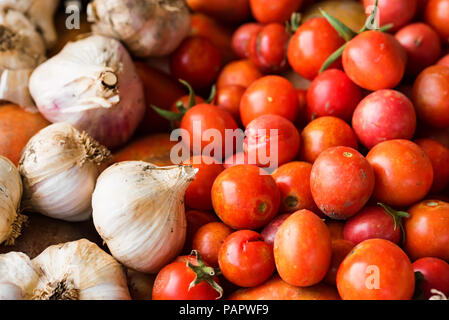Top view freshly picked tomatoes and garlic - Stock Photo