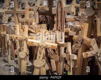 Many wooden crosses in the Hill of Crosses in Lithuania - Stock Photo