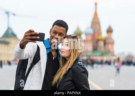 Russia, Moscow, couple taking a selfie and smiling - Stock Photo