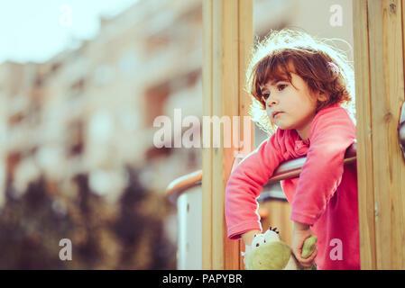Portrait of sad little girl at playground