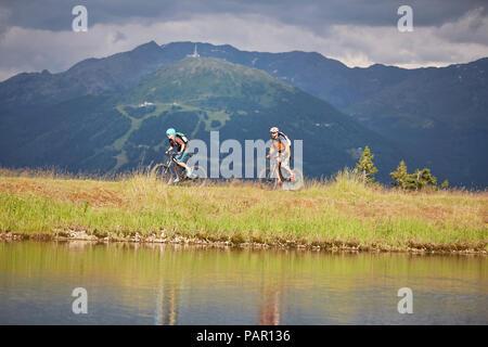 Austria, Tyrol, male and female mountainbiker - Stock Photo