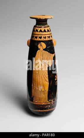 Terracotta alabastron (perfume vase). Culture: Greek, Attic. Dimensions: H. 5 13/16 in. (14.7 cm); diameter  13/16 in. (2 cm). Date: ca. 480 B.C..  Woman and Nike at altar, each with phiale.  Offering libations seems to have been an important role for women. Here a Nike (personification of victory), who looks very much like an Athenian lady with wings, and a mortal counterpart flank an altar. Each holds a phiale (libation bowl). It is likely that the sacrifice is for the successful return of a warrior or athlete. Museum: Metropolitan Museum of Art, New York, USA. - Stock Photo