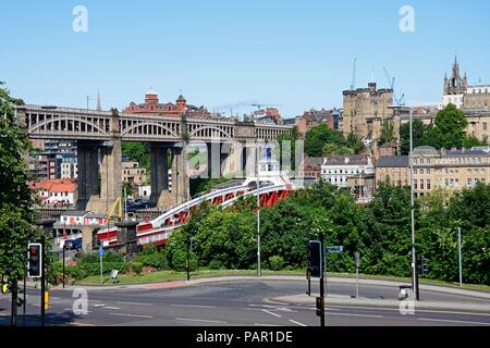 View across the River Tyne towards Newcastle upon Tyne with the medieval castle and St Nicholas Cathedral on the skyline and the High Level bridge to  - Stock Photo