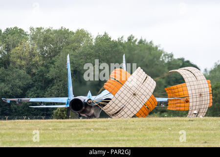 RAF FAIRFORD, GLOUCESTERSHIRE, UK JULY 2017: A Ukranian Air Force Sukhoi SU-27 Flanker deploys it's landing chutes as it lands at RAF Fairford during - Stock Photo