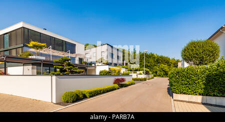 Germany, Blaustein, development area with sustainable residential houses - Stock Photo