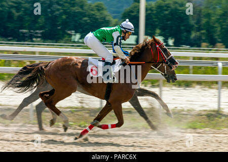 PYATIGORSK, RUSSIA - JULY 22, 2018:Horse racing for the prize of the Aragvi in Pyatigorsk,one of the largest and oldest racecourses in Russia. - Stock Photo