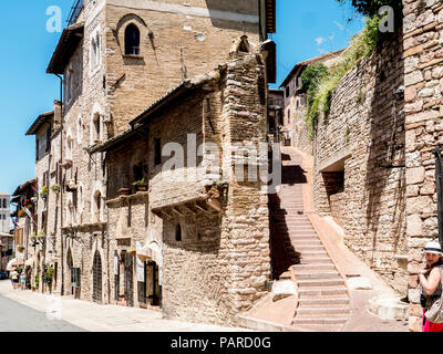 Steps and Shops on the charming medieval Via Frate Elia in the old town, Assisi, Umbria, Italy - Stock Photo