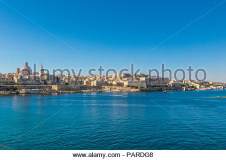 looking from sliema over marsamxett harbour to valletta with the st. paul's pro-cathedral and basilica of our lady of mount carmel, malta - Stock Photo