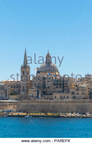 looking from manoel island over marsamxett harbour to valletta with the st. paul's pro-cathedral and basilica of our lady of mount carmel, malta - Stock Photo