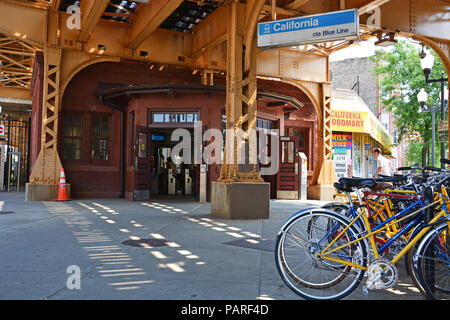 Commuter bicycles are parked outside the entrance to the California L Train Station on Chicago's Blue Line in the Logan Square neighborhood. - Stock Photo