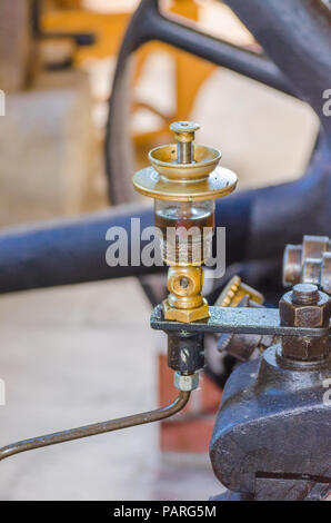 Close up of a steam engine Detail here in the picture Oil level gauge - Stock Photo
